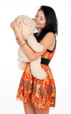Pretty brunette hugging a teddy bear Royalty Free Stock Photos