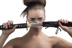Brunette in japan style with katana in front of the face Royalty Free Stock Images