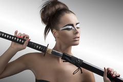 Brunette in japan style with katana and closed eyes Stock Photography