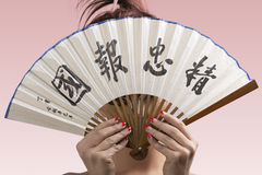 Pretty brunette in japan style with hidden face Stock Images