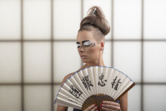 Pretty brunette in japan style turned at right Royalty Free Stock Photography