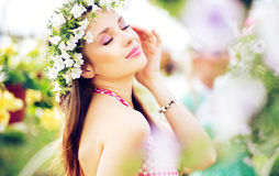 Pretty brunette lady with the colorful wreath on the head Royalty Free Stock Images