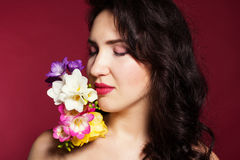 Pretty brunette lady with fresia flowers Royalty Free Stock Photography
