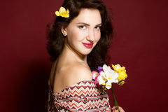 Pretty brunette lady with fresia flowers Royalty Free Stock Photo
