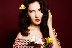 Pretty brunette lady with fresia flowers Royalty Free Stock Image