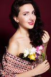 Pretty brunette lady with fresia flowers Royalty Free Stock Photos