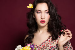 Pretty brunette lady with fresia flowers Stock Image