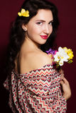 Pretty brunette lady with fresia flowers Stock Photo