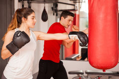Pretty brunette learning some boxing Stock Images