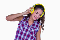 Pretty brunette listening music with headphone Stock Photography