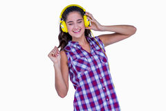 Pretty brunette listening music with headphone Stock Images