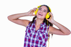 Pretty brunette listening music with headphone Royalty Free Stock Images