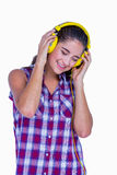 Pretty brunette listening music with headphone Royalty Free Stock Photos