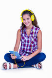 Pretty brunette listening music with her tablet computer Royalty Free Stock Photo