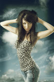 brunette with casual clothing and both hands on the head Royalty Free Stock Image