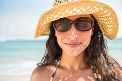 Pretty brunette looking at camera at the beach Stock Photo