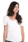 Pretty brunette looking sideways with hands in pockets isolated Stock Photography