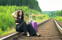 Pretty brunette looking for train Royalty Free Stock Images
