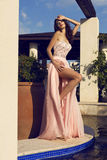 Pretty brunette in luxurious silk dress posing at summer garden royalty free stock photography