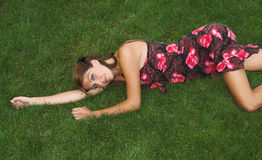 Pretty brunette lying on the grass Stock Photos