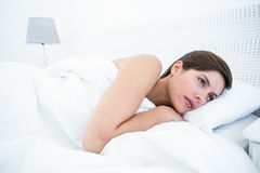 Pretty brunette lying in her bed Royalty Free Stock Image