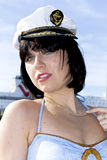 Pretty brunette in a marine cap Royalty Free Stock Photography