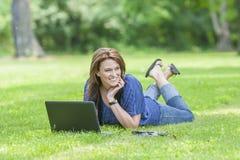 Pretty Brunette Model On Computer Stock Photo