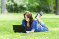 Pretty Brunette Model On Computer Royalty Free Stock Photos