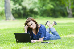 Pretty Brunette Model On Computer Stock Photo