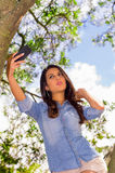 Pretty brunette model posing for a selfie while in Royalty Free Stock Photos