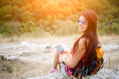 Pretty brunette near picturesque mountains stock images