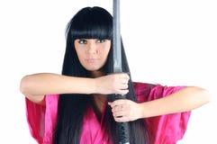 Pretty brunette ninja Stock Photo