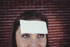 Pretty brunette with paper on head Stock Images