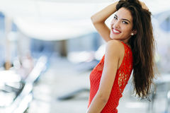 Pretty brunette with perfect smile. Posing Royalty Free Stock Image