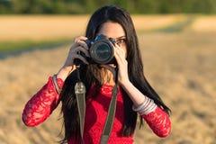 Pretty brunette photographer Stock Photo