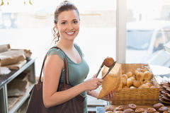 Pretty brunette picking out croissant Stock Images