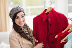 Pretty brunette picking out jacket Stock Photo