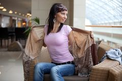 Pretty brunette is playing with a scarf Royalty Free Stock Images