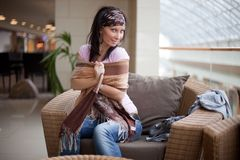 Pretty brunette is playing with a scarf Stock Photography