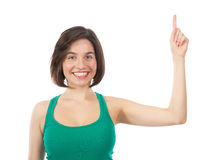 Pretty brunette pointing to the top Royalty Free Stock Photography
