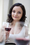 Pretty brunette posing with glass of red wine Royalty Free Stock Image