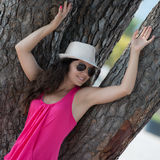 Pretty Brunette Posing Near A Tree Royalty Free Stock Images