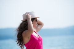 Pretty brunette posing  near the seaside Stock Photography