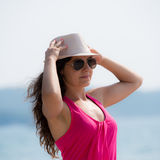 Pretty brunette posing  near the seaside Royalty Free Stock Photos