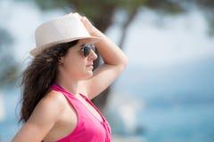 Pretty brunette posing  near the seaside Stock Image