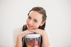 Pretty brunette preparing a healthy juice Stock Photo