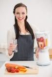 Pretty brunette preparing a healthy juice Stock Photos