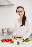 Pretty brunette preparing a healthy salad Royalty Free Stock Images