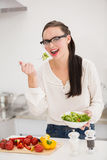 Pretty brunette preparing a healthy salad Stock Images