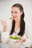 Pretty brunette preparing a healthy salad Royalty Free Stock Photo